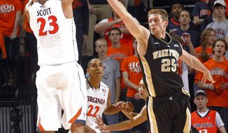 Virginia forward Mike Scott (23) shoots over Wake Forest forward Nikita Mescheriakov (25) during the first half of an NCAA basketball game Wednesday, Feb. 8, 2012, in Charlottesville, Va. (AP Photo/Andrew Shurtleff)