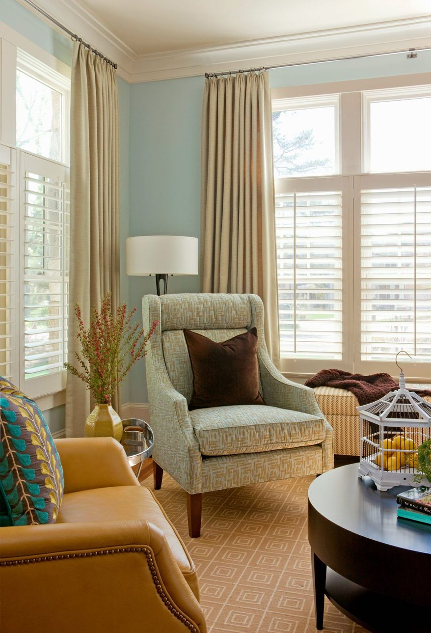 Photo by Angie Seckinger Photography Layering window treatments, such as using plantation shutters along with draperies can increase energy efficiency as well as add style.