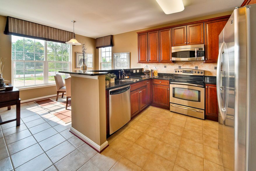 The kitchens feature stainless steel appliances, granite counters. The breakfast area in the Dogwood model has windows on two sides.