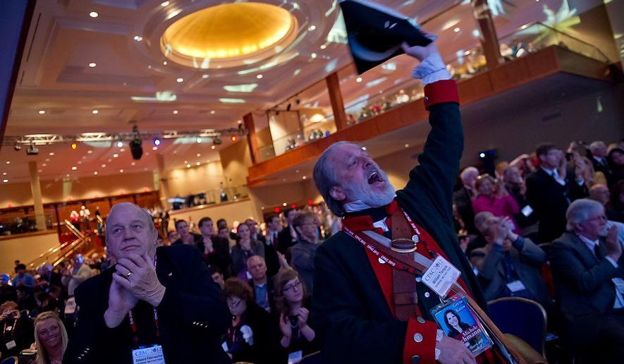 William Temple waves a three cornered hat for Sen. Marco Rubio (R-Fla.) while he speaks at the Conservative Political Action Conference (CPAC) held at the Marriott Wardman Park, Washington, DC, Thursday, February 9, 2012. The annual political conference draws thousands of supporters and prominent conservative figures. (Andrew Harnik / The Washington Times)