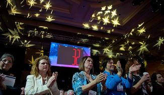 Audience members applaud as Former Presidential Candidate Michele Bachmann speaks at the Conservative Political Action Conference (CPAC) held at the Marriott Wardman Park, Washington, DC, Thursday, February 9, 2012. The annual political conference draws thousands of supporters and prominent conservative figures. (Andrew Harnik / The Washington Times)