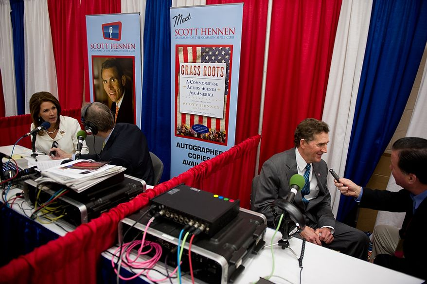 Former Presidential Candidate Michele Bachmann, left, and Sen. Jim DeMint (R-S.C.), second from right, are interviewed while attending the Conservative Political Action Conference (CPAC) held at the Marriott Wardman Park, Washington, DC, Thursday, February 9, 2012. The annual political conference draws thousands of supporters and prominent conservative figures. (Andrew Harnik / The Washington Times)