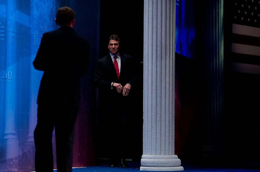 Former Presidential Candidate Rick Perry takes the stage to speak at the Conservative Political Action Conference (CPAC) held at the Marriott Wardman Park, Washington, DC, Thursday, February 9, 2012. The annual political conference draws thousands of supporters and prominent conservative figures. (Andrew Harnik / The Washington Times)