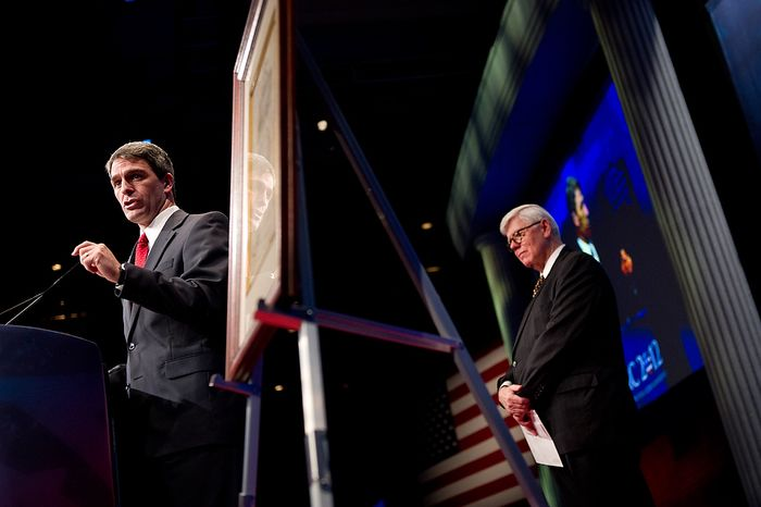 """Virginia Attorney General Ken Cuccinelli, left, speaks while accepting the """"Defender of the Constitution Award"""" from National Rifle Association President David Keene, right, at the Conservative Political Action Conference (CPAC) held at the Marriott Wardman Park, Washington, DC, Thursday, February 9, 2012. The annual political conference draws thousands of supporters and prominent conservative figures. (Andrew Harnik / The Washington Times)"""