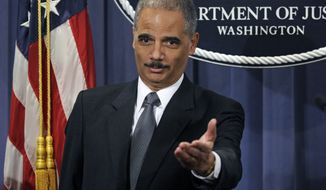 ** FILE ** Attorney General Eric H. Holder Jr. announces the formation of the Residential Mortgage-Backed Securities Working Group during a Jan. 27, 2012, news conference at the Justice Department in Washington. (Associated Press)