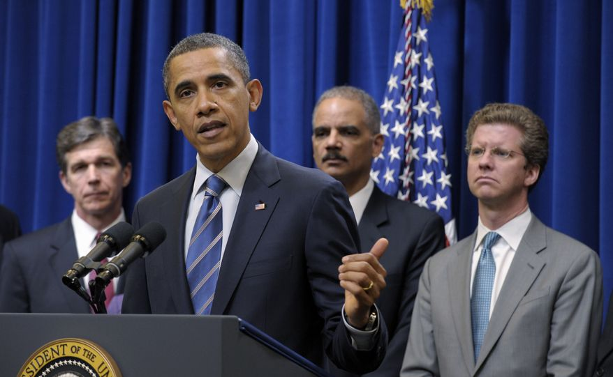President Obama (second from left) speaks about a settlement with the nation's five largest banks over foreclosures on Thursday, Feb. 9, 2012, in Washington. With the president are North Carolina Attorney General Roy Cooper (left), Attorney General Eric H. Holder Jr. (second from right) and Housing and Urban Development Secretary Shaun Donovan. (AP Photo/Susan Walsh)
