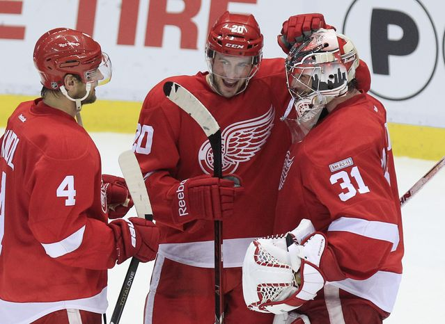 Detroit Red Wings goalie Joey MacDonald (31) is congratulated by teammates after their 4-2 home win over the Edmonton Oilers on Feb. 8, 2012. (Associated Press)