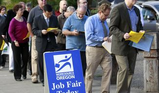 **FILE** People wait in line Sept. 15, 2011, at the Maximum Connections Job and Career Fair in Portland, Ore. (Associated Press)