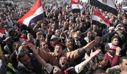 Egyptian protesters wave national flags and chant anti-Supreme Council of Armed Forces slogans during a protest Feb. 10, 2012, after prayers in Cairo's Tahrir Square, the focal point of Egyptian uprising. (Associated Press)