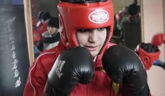 ** FILE ** In this photo taken Wednesday, Feb. 1, 2012, Sadaf Rahimi, an Afghan woman boxer, practices at a boxing club in Kabul, Afghanistan. As one of the first women to ever box in the Olympics, besides going after a medal in the boxing ring at the London Olympics, Sadaf Rahimi will be taking a few punches in the fight for equal rights for Afghan women. (AP Photo/Musadeq Sadeq)