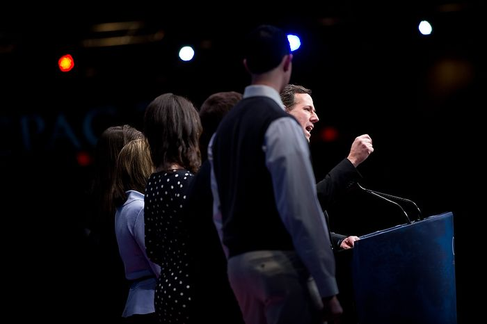 Republican presidential candidate and former Pennsylvania Sen. Rick Santorum is surrounded by his family while speaking Feb. 10, 2012, at the Conservative Political Action Conference (CPAC) in Washington. (Andrew Harnik/The Washington Times)