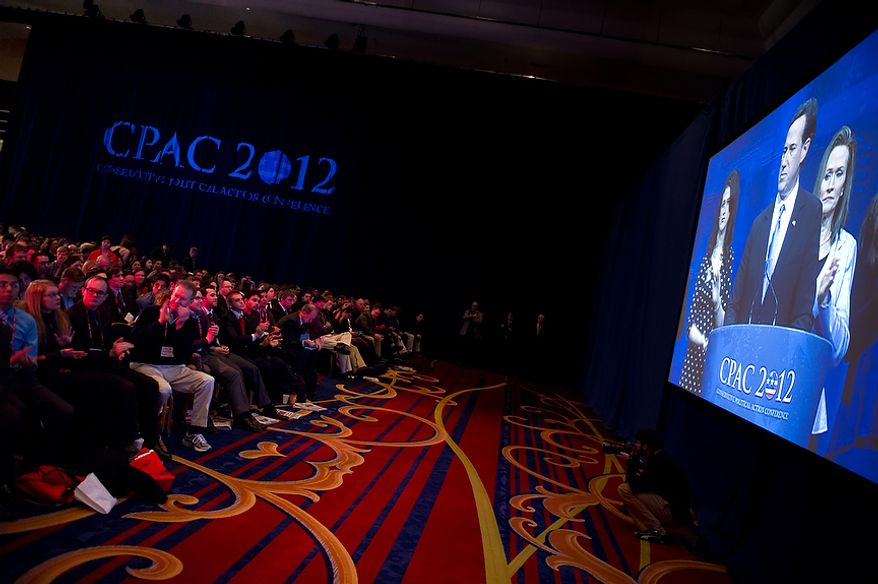 Audience members applaud Feb. 10, 2012, as Republican presidential candidate and former Pennsylvania Sen. Rick Santorum as he speaks at the Conservative Political Action Conference (CPAC) in Washington. (Andrew Harnik/The Washington Times)