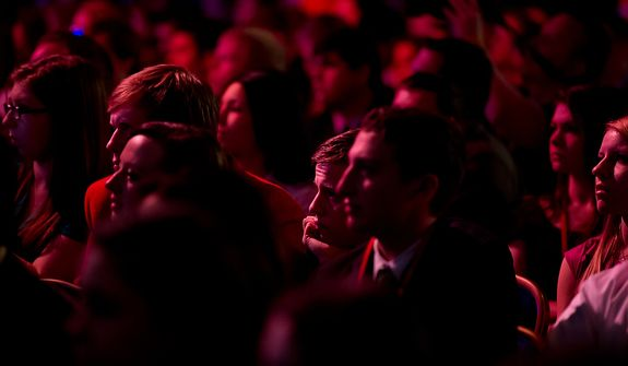 Audience members listen Feb. 10, 2012, to Republican presidential candidate and former Pennsylvania Sen. Rick Santorum as he speaks at the Conservative Political Action Conference (CPAC) in Washington. (Andrew Harnik/The Washington Times)