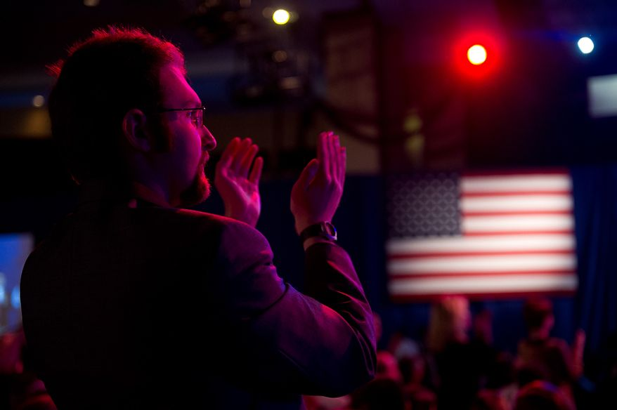 Audience member Joseph La Russa stands and applauds Feb. 10, 2012, during a speech by Republican presidential candidate and former Pennsylvania Sen. Rick Santorum at the Conservative Political Action Conference (CPAC) in Washington. (Andrew Harnik/The Washington Times)