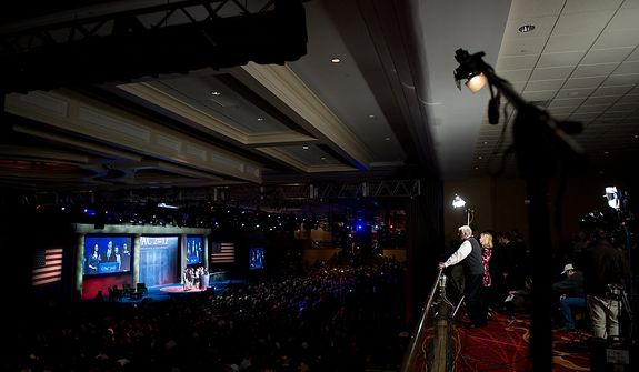Members of the press listen Feb. 10, 2012, from a balcony to Republican presidential candidate and former Pennsylvania Sen. Rick Santorum as he speaks at the Conservative Political Action Conference (CPAC) in Washington. (Andrew Harnik/The Washington Times)