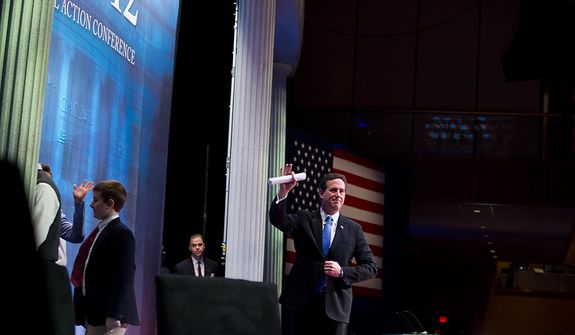Republican presidential candidate and former Pennsylvania Sen. Rick Santorum waves Feb. 10, 2012, after speaking at the Conservative Political Action Conference (CPAC) in Washington. (Andrew Harnik/The Washington Times)