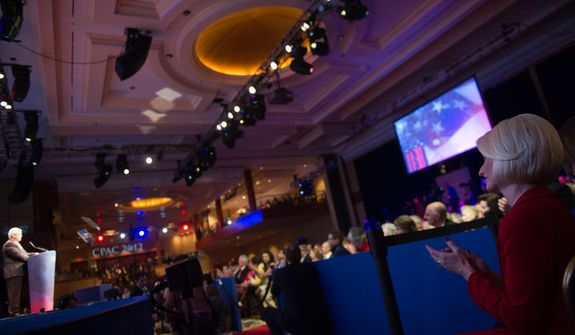 Callista Gingrich, right, listens to her husband, Republican Presidential Candidate and former Speaker of the House Newt Gingrich as he speaks at the Conservative Political Action Conference (CPAC) held at the Marriott Wardman Park, Washington, D.C., Friday, February 10, 2012. The annual political conference draws thousands of supporters and prominent conservative figures. (Andrew Harnik/The Washington Times)