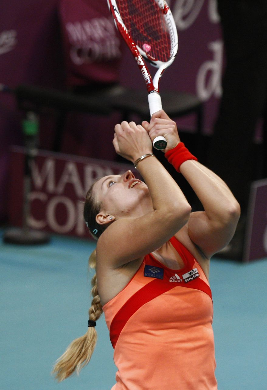 Angelique Kerber reacts after defeating Maria Sharapova 6-4, 6-4 during their quarterfinal singles match at the GDF Suez WTA Open 2012 tennis tournament at Coubertin stadium in Paris on Friday, Feb. 10, 2012. ( AP Photo/Michel Euler)