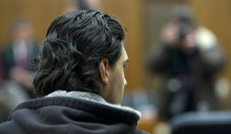 Arid Uka, 22, sits Feb, 10, 2012, in a Frankfurt court room. The Islamic extremist, who admitted killing two U.S. airmen bound for Afghanistan at Frankfurt airport last year, was convicted of murder and sentenced to life in prison. (Associated Press/DADP)