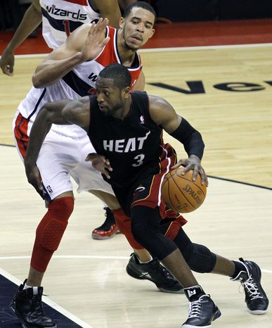 Miami Heat guard Dwyane Wade had a game-high 26 points as the Heat defeated the Wizards, 106-89. (AP Photo/Jacquelyn Martin)