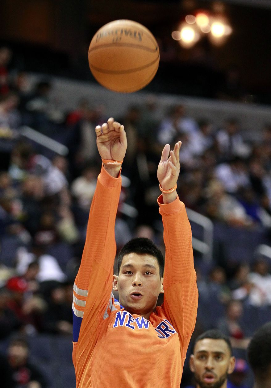New York Knicks point guard Jeremy Lin shoots baskets before the start of a game against the Washington Wizards on Feb. 8, 2012, in Washington. (Associated Press)