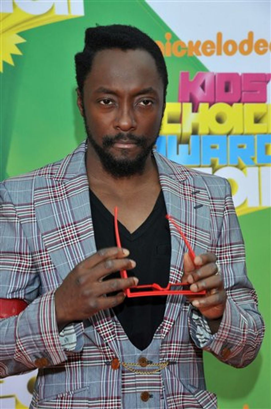 FILE - In this April 2, 2011 file photo, Will.i.am of the Black Eyed Peas arrives at Nickelodeon's 24th Annual Kids' Choice Awards in Los Angeles. Will.i.am is hosting a concert to benefit his i.am.angel foundation on Thursday, Feb. 9, 2012. (AP Photo/Vince Bucci, file )