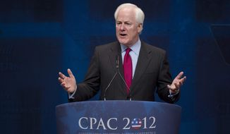 Sen. John Cornyn, R-Texas, criticizes U.S. Attorney General Eric Holder as he speaks to activists from America's political right at the Conservative Political Action Conference (CPAC) in Washington, Saturday, Feb. 11, 2012. (AP Photo/J. Scott Applewhite)