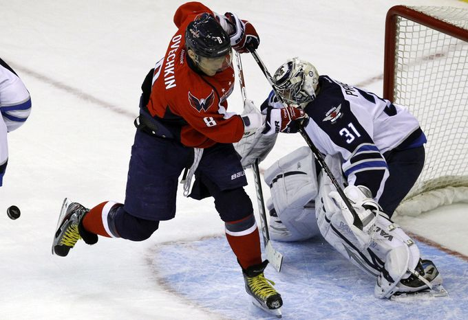 Washington Capitals left wing Alex Ovechkin misses a shot against Winnipeg Jets goalie Ondrej Pavelec during the second period Thursday, Feb. 9, 2012. Ovechkin had a goal and an assist in the 3-2 shootout loss. (AP Photo/Jacquelyn Martin)