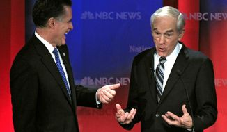 ** FILE ** In this Jan. 23, 2012, file photo, Republican presidential candidates, Rep. Ron Paul, R-Texas, right, and former Massachusetts Gov. Mitt Romney share a laugh during a break in a Republican presidential debate at the University of South Florida in Tampa, Fla. (AP Photo/Chris O'Meara, File)