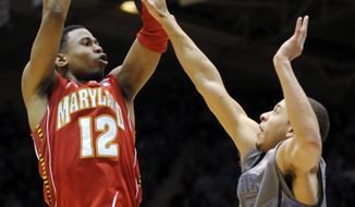 Maryland's Terrell Stoglin shoots over Duke's Seth Curry during the second half Saturday, Feb. 11, 2012, in Durham, N.C. Duke won 73-55. (AP Photo/Sara D. Davis)