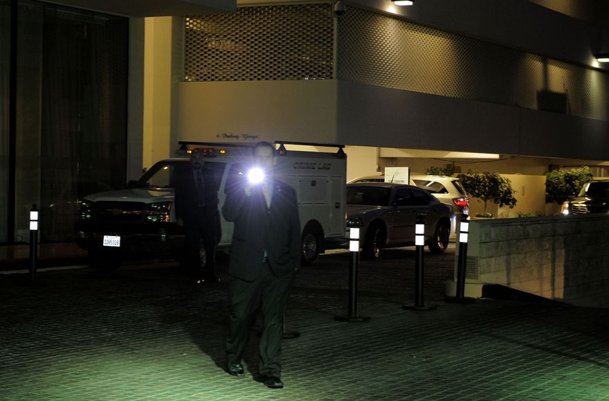 Security gather outside the Beverly Hilton Hotel Saturday Feb. 11, 2012 in Beverly Hills Calif. Whitney Houston, who ruled as pop music's queen until her majestic voice and regal image were ravaged by drug use, erratic behavior and a tumultuous marriage to singer Bobby Brown, died Saturday, Feb. 11, 2012. She was 48.(AP Photo/Mark J. Terrill)