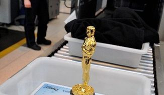 A genuine Oscar statue awaits its security check at O'Hare International Airport in Chicago before its flight to Los Angeles. (Associated Press)