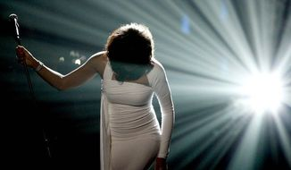 Whitney Houston performs onstage at the 37th Annual American Music Awards in Los Angeles on Nov. 22, 2009. The cause of the singer's death on Saturday is under investigation. (Associated Press)