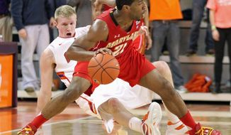 Maryland guard Pe'Shon Howard, shown against Clemson on Feb. 7, was lost for the rest of the season Thursday when he tore the ACL in his right knee. (Associated Press)