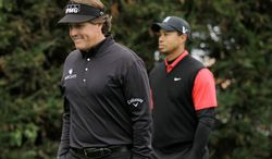 Phil Mickelson (left) shot a closing-round 64 - 11 strokes better than Tiger Woods (right) - in winning the Pebble Beach National Pro-Am by two shots over Charlie Wi. (Associated Press)