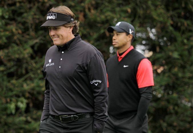 Phil Mickelson (left) shot a closing-round 64 - 11 strokes better than Tiger Woods (right) - in winning the Pebble Beach National Pro-Am by two shots over Charlie Wi. (A