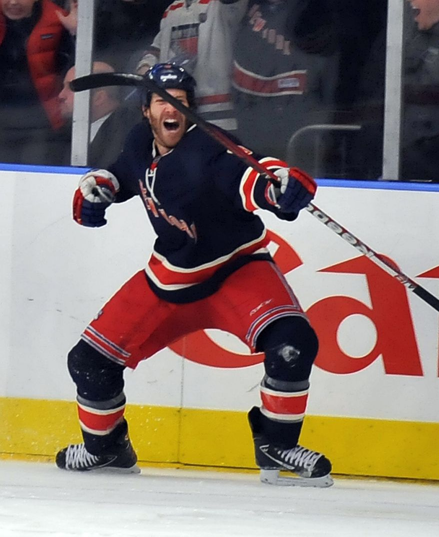 New York Rangers' Brandon Prust celebrates his short-handed goal in the third period of an NHL game against the Washington Capitals in New York, Sunday, Feb. 12, 2012. (AP Photo/Newsday, David Pokress)