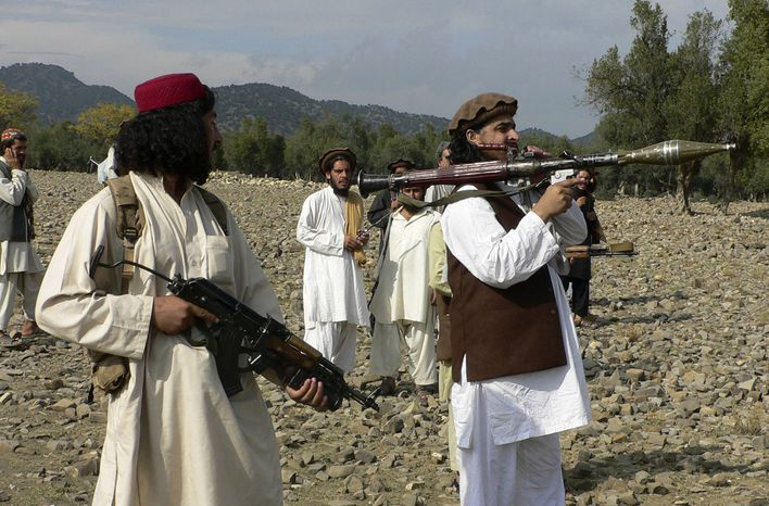 ** FILE ** Pakistani Taliban chief Hakimullah Mehsud (right) holds a rocket launcher with his comrades in Sararogha in the Pakistani tribal area of South Waziristan, along the Afghanistan border, in October 2009. (AP Photo/Ishtiaq Mehsud)