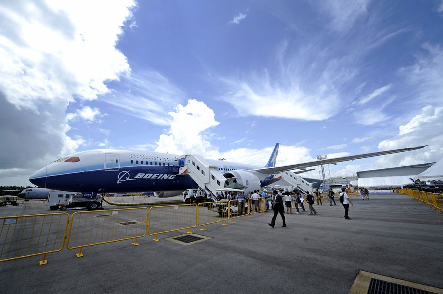 Members of the media board a Boeing 787 Dreamliner during a press preview in Singapore on Sunday, Feb. 12, 2012, prior to the Singapore Airshow 2012. (AP Photo/Bryan van der Beek)