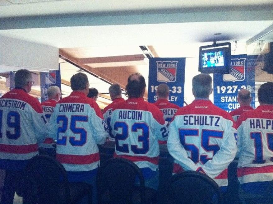 Dads and mentors in Madison Square Garden suite. (Photo by James Heuser / Washington Capitals)