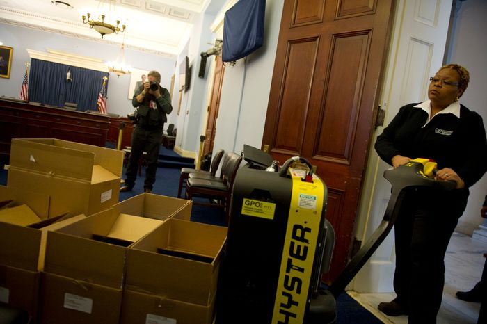 Cheryl Kitchens, a Government Printing Office receiving clerk, delivers the printed version of the Office of Management and Budget's fiscal 2013 budget on a pallet to the House Committee on the Budget in the Cannon House Office Building on Capitol Hill in Washington on Monday, Feb. 13, 2012. (Rod Lamkey Jr./The Washington Times)