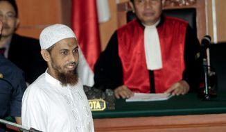 Umar Patek, an Indonesian militant charged in the 2002 Bali terrorist attacks, arrives Feb. 13, 2012, to his trial in Jakarta, Indonesia. (Associated Press)
