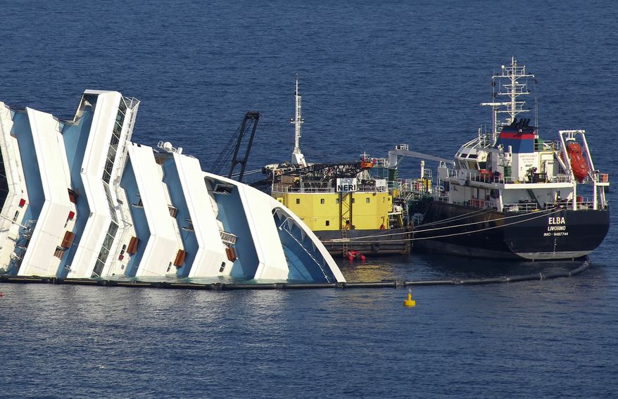 Ongoing operations to remove fuel from the half-sunken hulk of the luxury ship Costa Concordia a month after it ran aground are seen outside the port of Isola del Giglio, off Italy's Tuscan coast, on Monday, Feb. 13, 2012. (AP Photo/Giorgio Fanciulli)