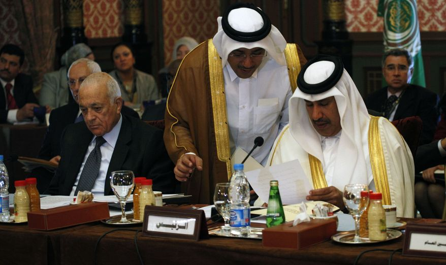 Arab League chief Nabil Elaraby (left) and Sheikh Hamad Bin Jassim Althani (right), the Qatari prime minister, attend a meeting in Cairo on Sunday, Feb. 12, 2012, at which the organization considered a proposal to revive its suspended observer mission in Syria by expanding it to include monitors from non-Arab Muslim nations and the United Nations. (AP Photo/Nasser Nasser)