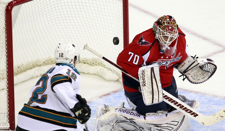 San Jose Sharks left wing Patrick Marleau (12) scores on Washington Capitals goalie Braden Holtby during the second period of an NHL game, Monday, Feb. 13, 2012, in Washington. (AP Photo/Haraz N. Ghanbari)