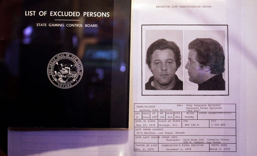 "A casino black book, or list of excluded persons, on display includes Anthony Spilotro, who is seen in other parts of the museum making his First Communion. He was the model for Joe Pesci's character in Martin Scorsese's ""Casino."" (Associated Press)"