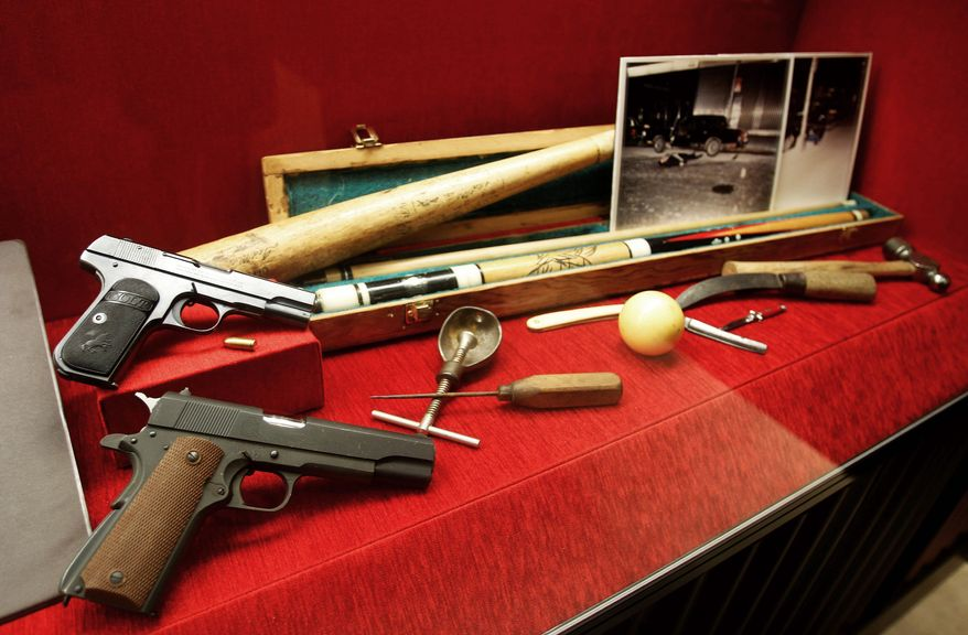 Weapons on display include not just the expected guns but an oddball collection that includes a shovel, a hammer, a baseball bat and an ice pick. (Associated Press)