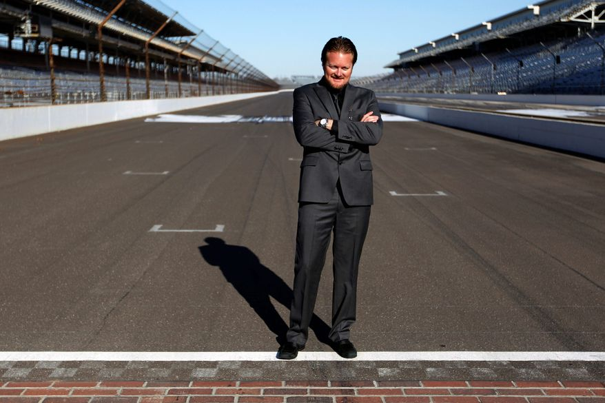 FILE - In this Jan. 4, 2012, file photo, Beaux Barfield poses on the start/finish line after he was named to replace Brian Barnhart as the IndyCar race director during an announcement at the Indianapolis Motor Speedway in Indianapolis. With the IndyCar Series still recovering from Dan Wheldon's death, Barfield said Tuesday, Feb. 14, 2012, double-file restarts would be scrapped at Indianapolis, Texas and Fontana and more changes to improve safety could be announced before next month's season-opener at St. Petersburg. (AP Photo/Michael Conroy, File)