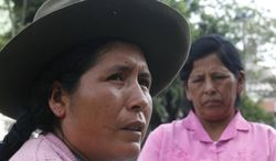 In this photo taken on Feb. 3, 2012, Maximiliana Quillahuaman, left, talks as Micaela Flores looks on after an interview in Lima, Peru. Quillahuaman and Flores were both coerced into being sterilized during a 1995-2000 program that sterilized more than 300,000 women, mostly poor, illiterate Indians. (AP Photo/Martin Mejia)
