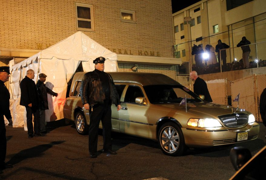 The body of Whitney Houston arrives at the Whigham Funeral Home in Newark, N.J., on Monday, Feb. 13, 2012. (AP Photo/Rich Schultz)